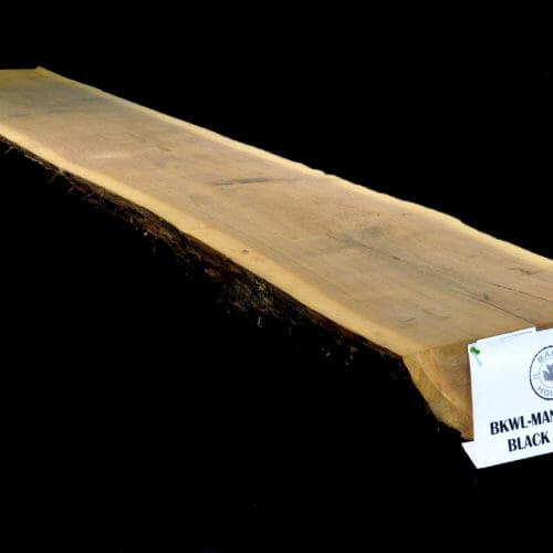 Black walnut live edge slab mantle for sale at The Bark House. #BKWL-MAN-12-0018