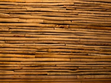 Unique wall covering of mixed hard wood peeled bark poles
