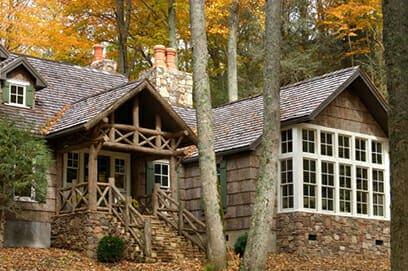Exterior bark shingle siding on a residence in the autum