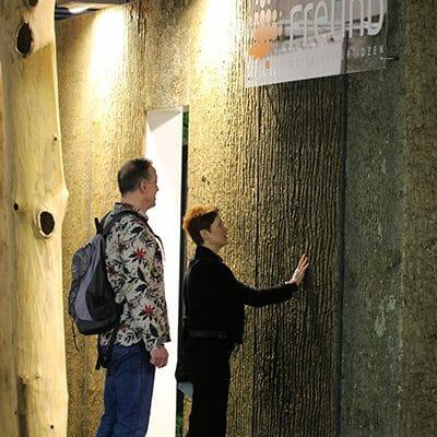 Woman feels the ultimate texture of Bark House Poplar Bark Panel Sheets