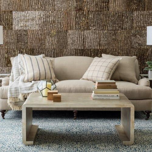Annie Selke, Pine Cone Hill, uses Bark House Poplar Bark interior shingles for a beautiful backdrop to rugs: blue rug