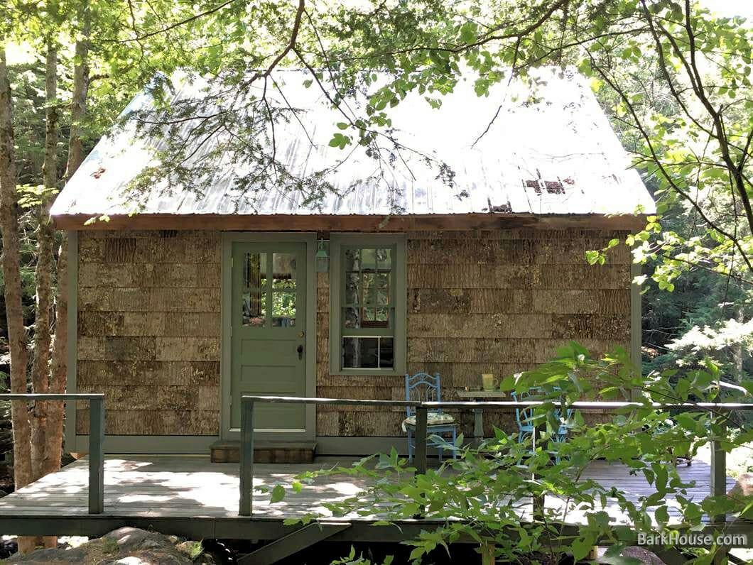 Bark House exterior tulip poplar natural bark shingle siding on Ben Cohen's cabin