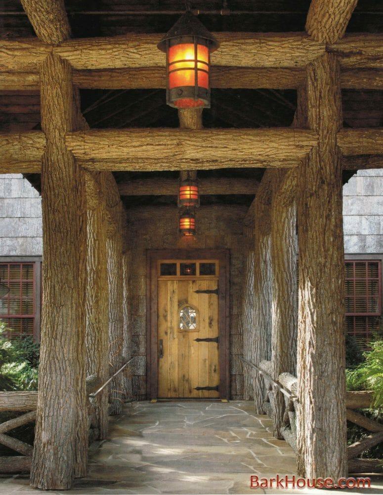 Bark House at Highland Craftsmen's Bark Intact Poplar Poles support entry way