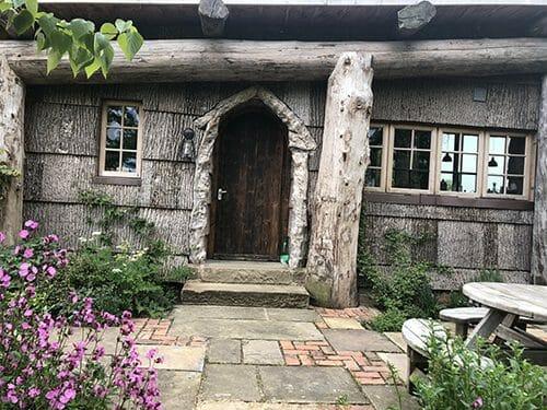 Bark House poplar exterior shingle siding on guest house in United Kingdom