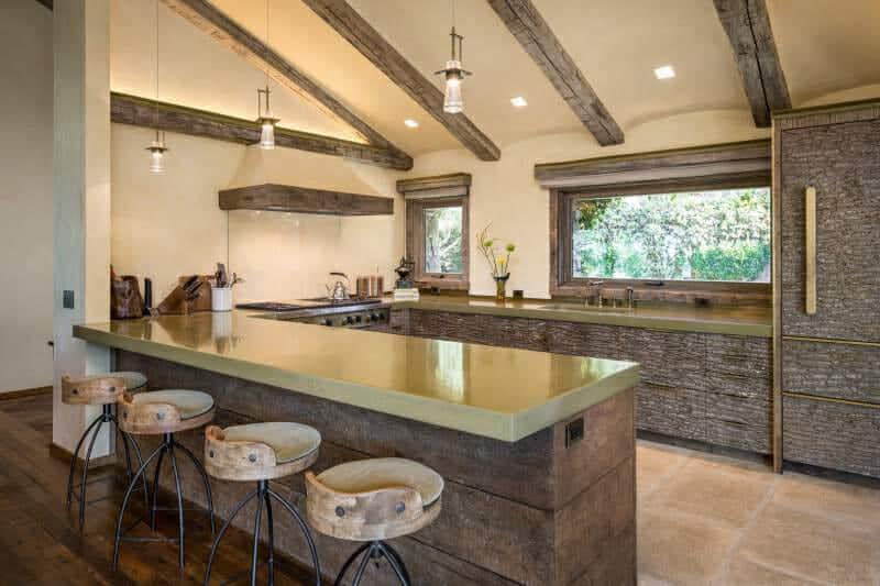Designer uses horizontal oriented poplar bark panels to make kitchen cupboards unique.